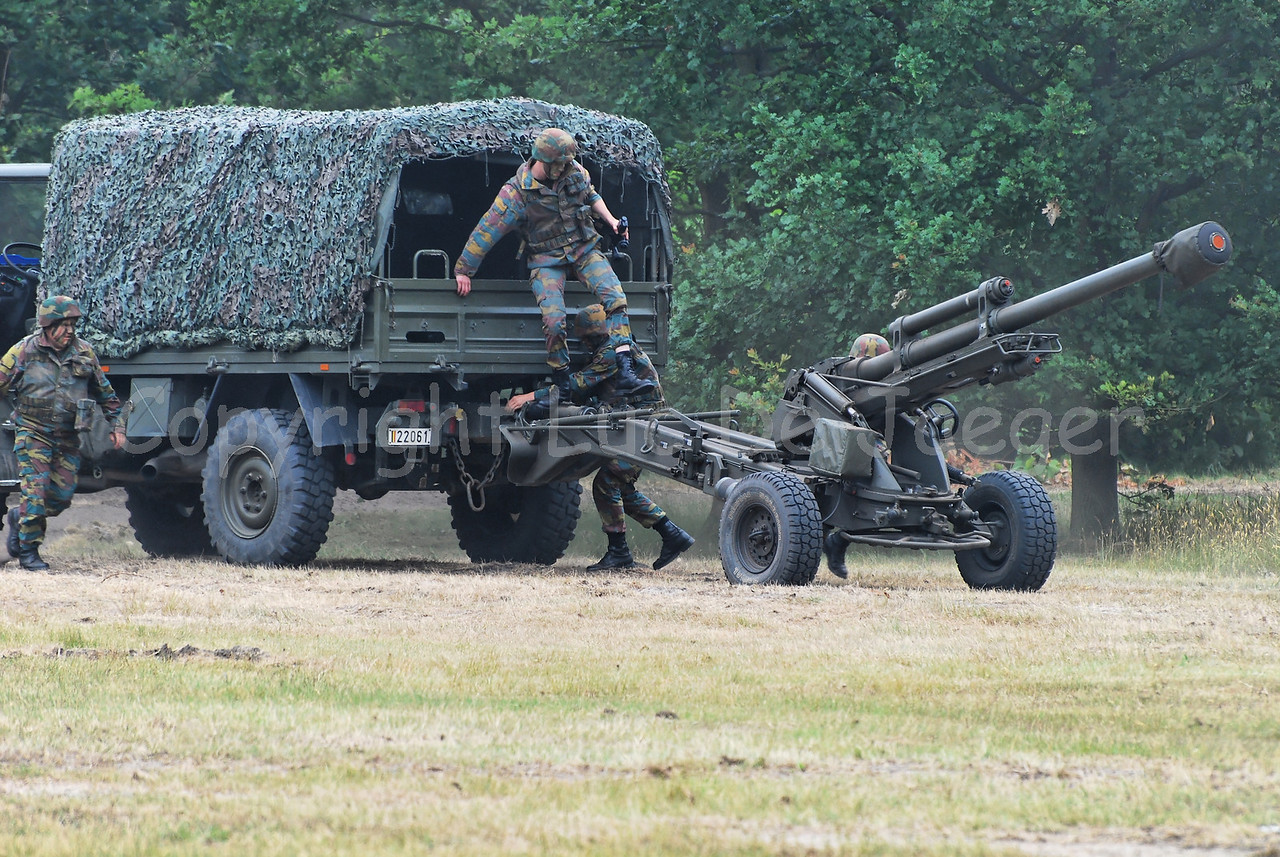 A Unimog vehicle of the Belgian Artillery with a LG1 105 mm/30-calibre towed howitzer.