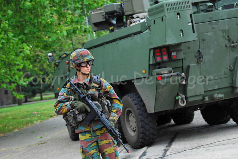 An infantry soldier of the Belgian Army in training. He wears goggles by Revision Eyewear and handles the FN FNC (assault) rifle. The soldier accompanies the brand new AIV (Armoured Infantry Vehicle) Piranha IIIC manufactured by MOWAG that will replace the Leopard 1A5 MBT in the Belgian Army.