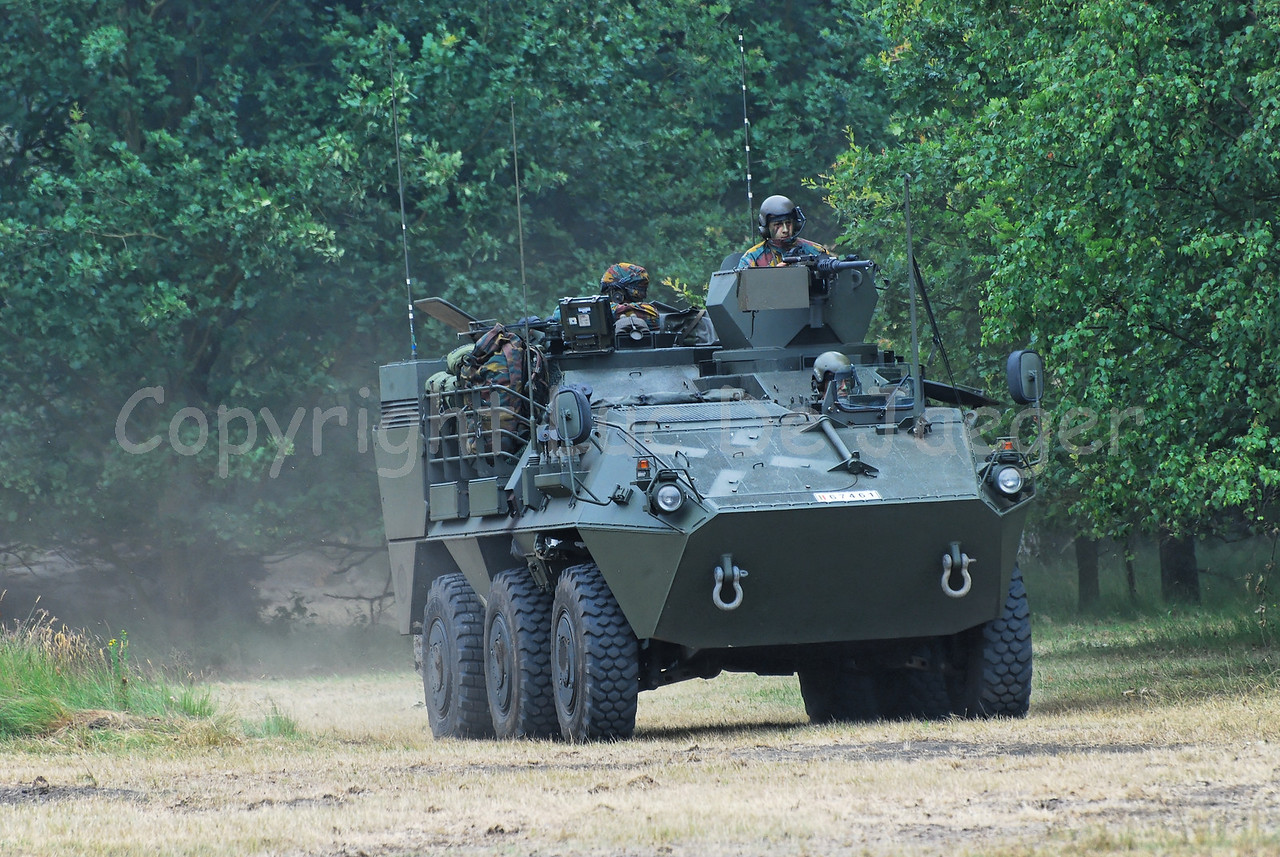 The Pandur Recce Vehicle proceeding in the fields.