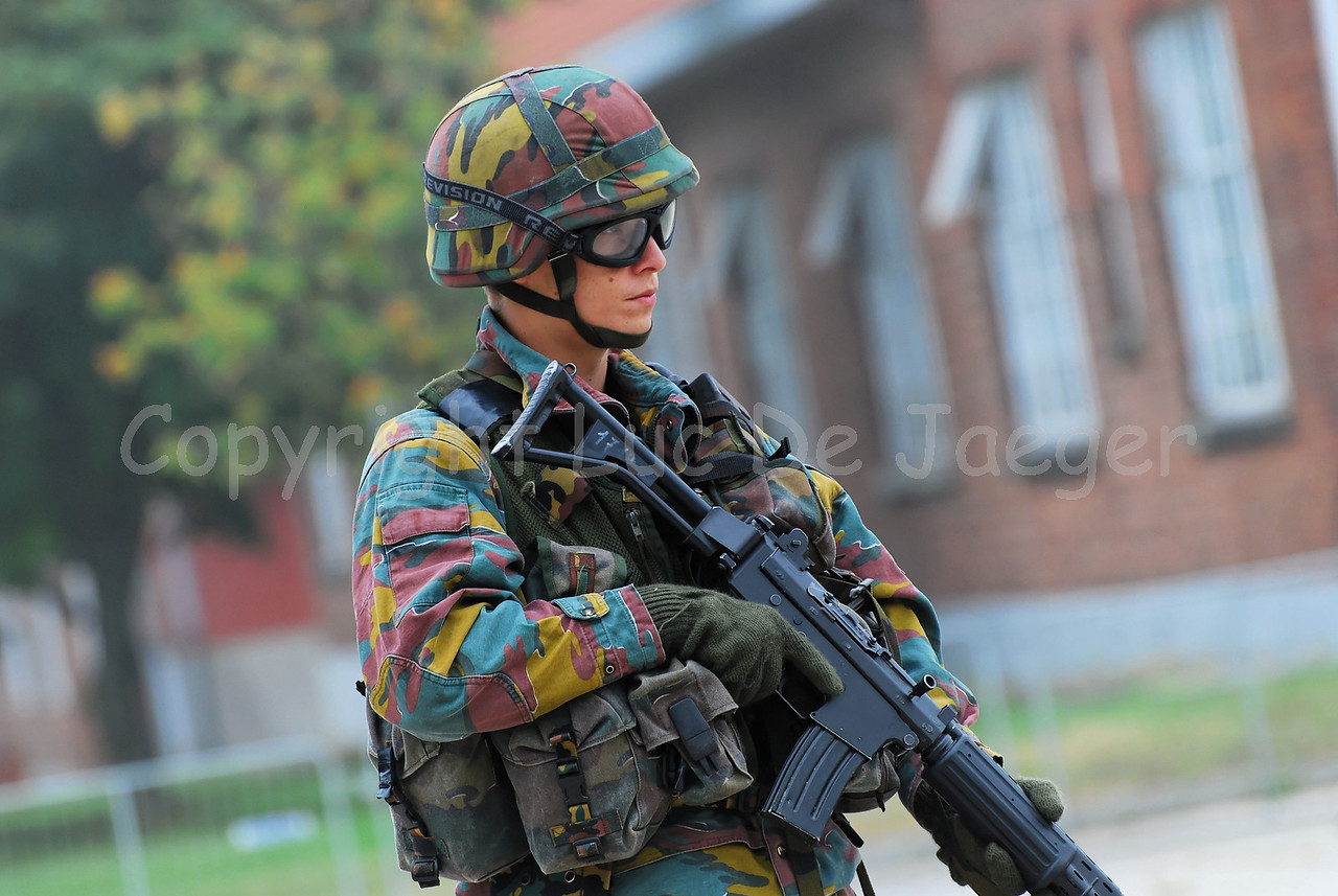 An infantry soldier of the Belgian Army in training. He wears goggles by Revision Eyewear and handles the FN FNC (assault) rifle.
