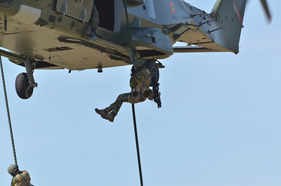 Pathfinders of the Belgian Army demonstrating fast roping techniques and descending from the NH-90 helicopter (in use since 2014).