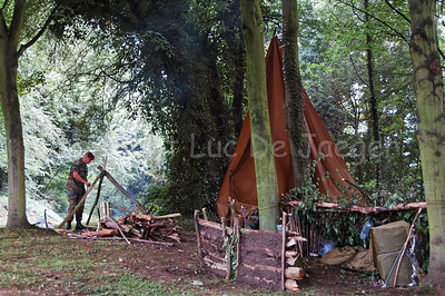 Training in survival techniques in an improvised base (camp) set up in the woods.