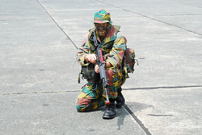 A paratrooper on the guard. He's handling the FNC rifle.