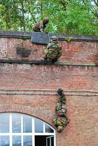 Paratroopers descending in rappel in a hostage rescue operation (HRO) training session.