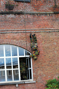 A paratrooper descending in rappel in a hostage rescue operation (HRO) training session.