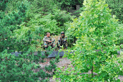 Two paratroopers resting before the hostage rescue training session.