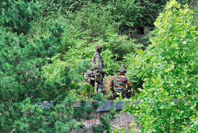 Paratroopers in the bushes getting ready for the hostage rescue session.
