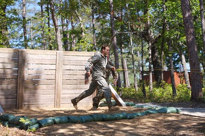 These shots follow team 41's MSG Turk & SFC Grunewald through the 'Darby Queen' obstacle course.  They, and other Ranger teams, are featured in remaining fotos of the competitino