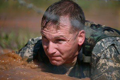MAJ Purdy negotiates the mud & barbedwire crawl