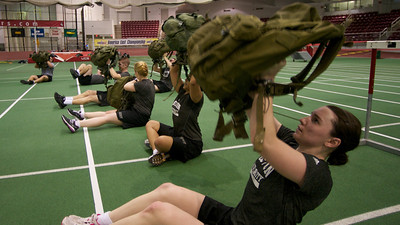 Feb. 17, 2012, Boston, MA - Members of the Boston University ROTC go through their physical training early Friday morning at the school's Track and Tennis Center on Ashford Street. Photo By Ryan Hutton