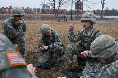 Boston, MA, Feb. 16, 2012 - Members of the Boston University Reserve Officers' Training Corps run a training exercise on the Charles River esplanade Thursday afternoon. Here, cadets discuss how to best secure the site of a simulated improvised exlosive device (IED) blast. Photo by Ryan Hutton