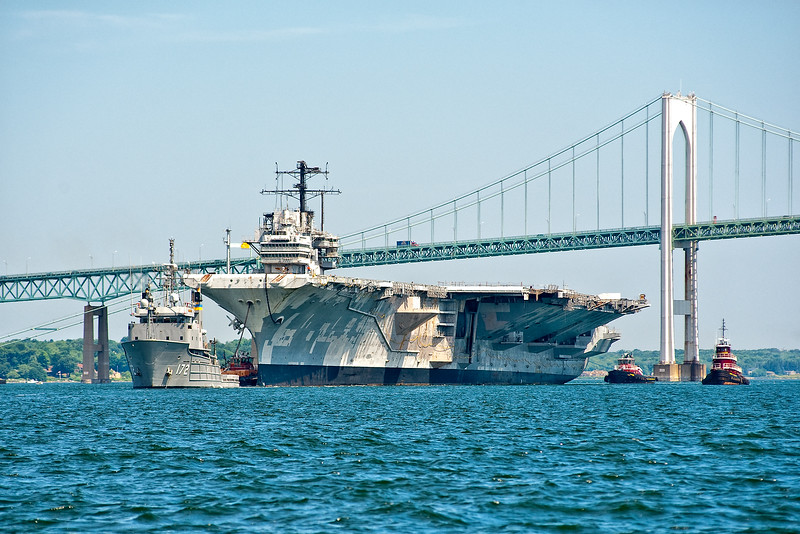USNS Apache towing the USS Forrestal CVA 59 out of the East Passage of Narragansett Bay.