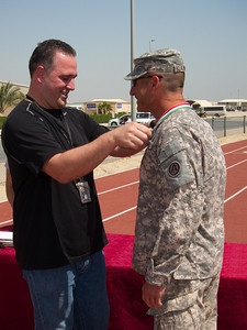 COL Klajnbart receiving his medal.