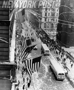 V-E Day in NYC. Ticker tape parade at the corner of Broadway and Wall Street. 1945