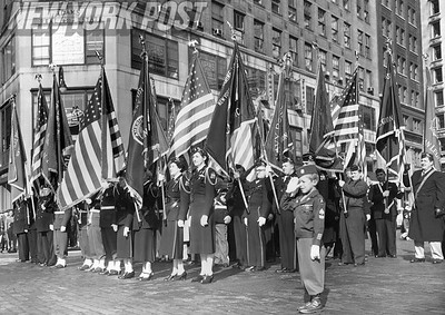 Group of American Legion members stand at salute during the 1953 Armistice Day Parade in New York City. 1953