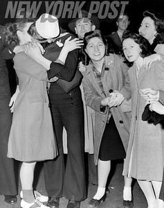 V-E Day celebratory KISS for this sailor in NYC Times Square! 1945
