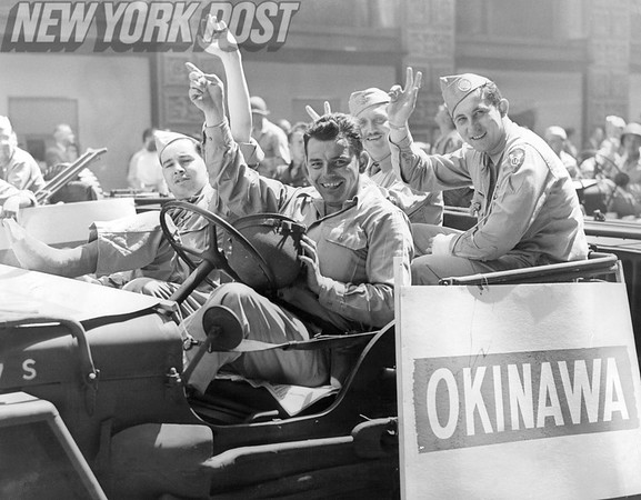 Servicemen thrilled to be back on American soil after serving in World War II in Okinawa. 1945