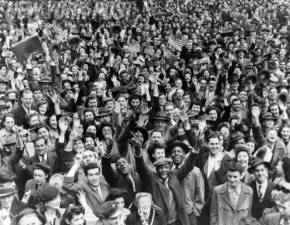 Crowds in NYC Time Square celebrate V-E Day. 1945