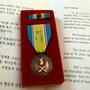 Recent medal from Korea given to Korean War veteran and retired Marine Ray Bratton of Chelmsford, who did a draft design and advocated for a Korean War memorial, to be unveiled at the Veteran's Day ceremony at Chelmsford Veterans Memorial Park. (SUN/Julia Malakie)
