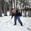 Mike Kendrick, chair of the Chelmsford Veterans Memorial Park Committee, picks up a broken branch. The committee is seeking to add two additional stones once they have enough veterans' names, and financial support. (SUN Julia Malakie)