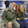 Airman Steven Lubinger, 18, of Chelmsford, with his mother Kubryn Panzeri of Chelmsford, after surprising his three younger brothers at one's Squirt 1 hockey game at Breakaway Ice Center. (SUN/Julia Malakie)