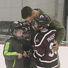 Airman Steven Lubinger, 18, of Chelmsford, surprises his younger brothers, from left, Gabe, 7, Ben, 8, and Cam Panzeri, 9, at Cam's Squirt 1 hockey game at Breakaway Ice Center. (SUN/Julia Malakie)