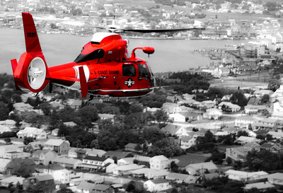 I was shooting from another Dolphin Helicopter near the Barnegate Light in New Jersey.  We launched two Dolphin Helicopters, from Air Station Cape May, to take a shot of one of them hovering near the lighthouse for a baseball card.