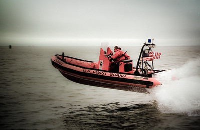 A 21-foot rigid hull inflatable boat launches off a wave off the coast of New Jersey.