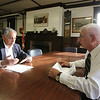Dean Contover of Chelmsford, left, is working with Brig. Gen. (MA) Leonid Kondratiuk, researching Lowell area service members who were killed in Vietnam. Historical military archives currently stored in the Concord Armory, on Everett Street in Concord, will be moved to the state archives in Dorchester later this year. (SUN/Julia Malakie)