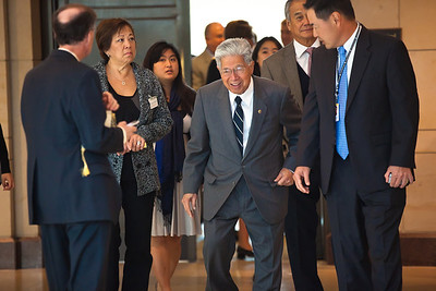 Senator Daniel Akaka (D-Hawaii) (center) enters Emancipation Hall to attend ceremony.