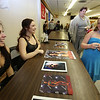 """""""2018 Contribute to the Troops"""" at Lowell VFW Post 662. From left, wrestlers Cathy Bazylewicz of Somersworth, N.H. (wrestling name """"The Widow Belmont""""), Nicki Tebeau of Plaistow, N.H. (""""Sammi Lane"""") and Candice Minnick, 10, of Lowell, whose uncle helped organize the event. (SUN/Julia Malakie)"""