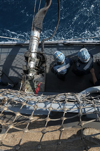091125-N-0260R-023 - GULF OF ADEN (Nov. 25, 2009) - Sailors from the USS Chosin (CG 65) man a refueling station during and underway replenishment  (UNREP) with USNS John Lenthall. Chosin is the flagship of Combined Joint Task Force 151, a multinational task force established to conduct counter-piracy operations under a mission-based mandate to actively deter, disrupt, and suppress piracy off the coast of Somalia. (U.S. Navy photo by Mass Communication Specialist 1st Class Brandon Raile/Not Released)