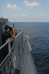091218-N-0260R-016 - GULF OF ADEN (Dec. 18, 2009) - A Sailor from the USS Chosin (CG 65) mans a look out station during an underway replenishment (UNREP) with USNS Kanawha. Chosin is the flagship of Combined Joint Task Force 151, a multinational task force established to conduct counter-piracy operations under a mission-based mandate to actively deter, disrupt, and suppress piracy off the coast of Somalia. (U.S. Navy photo by Mass Communication Specialist 1st Class Brandon Raile/Not Released)