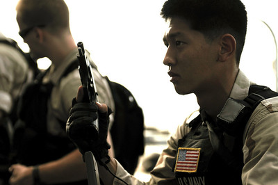 091209-N-0260R-041 - GULF OF ADEN (Dec. 09, 2009) - Gunner's Mate 2nd Class Alben Osaki practices weapons drills during a training evolution for the USS Chosin's (CG 65) Visit Board Search and Seizure (VBSS) team. Chosin is the flagship of Combined Joint Task Force 151, a multinational task force established to conduct counter-piracy operations under a mission-based mandate to actively deter, disrupt, and suppress piracy off the coast of Somalia. (U.S. Navy photo by Mass Communication Specialist 1st Class Brandon Raile/Released)