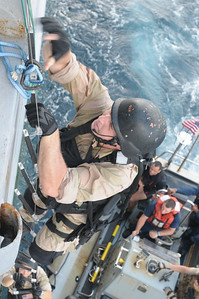 091124-N-0260R-038 - GULF OF ADEN (Nov. 24, 2009) - Members of the USS Chosin's (CG 65) Visit Board Search and Seizure (VBSS) team practice boarding techniques from one the ship's Rigid Hull Inflatable Boats (RHIB). Chosin is the flagship of Combined Joint Task Force 151, a multinational task force established to conduct counter-piracy operations under a mission-based mandate to actively deter, disrupt, and suppress piracy off the coast of Somalia. (U.S. Navy photo by Mass Communication Specialist 1st Class Brandon Raile/Released)