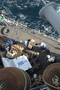 091125-N-0260R-074 - GULF OF ADEN (Nov. 25, 2009) - Sailors from the USS Chosin (CG 65) move stores from pallets brought over from the USNS John Lenthall during an underway replenishment  (UNREP). Chosin is the flagship of Combined Joint Task Force 151, a multinational task force established to conduct counter-piracy operations under a mission-based mandate to actively deter, disrupt, and suppress piracy off the coast of Somalia. (U.S. Navy photo by Mass Communication Specialist 1st Class Brandon Raile/Not Released)