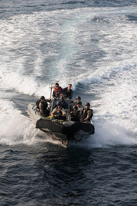 091129-N-0260R-003 - GULF OF ADEN (Nov. 29, 2009) - Members of the USS Chosin's (CG 65) Visit Board Search and Seizure (VBSS) team approach the ship in a Rigid Hull Inflatable Boat (RHIB) to practice ladder boarding techniques. Chosin is the flagship of Combined Joint Task Force 151, a multinational task force established to conduct counter-piracy operations under a mission-based mandate to actively deter, disrupt, and suppress piracy off the coast of Somalia. (U.S. Navy photo by Mass Communication Specialist 1st Class Brandon Raile/Released)