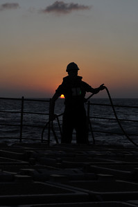 091212-N-0260R-059 - GULF OF ADEN (Dec. 12, 2009) - A Sailor from the USS Chosin (CG 65) mans a line during an underway replenishment (UNREP) with USNS Kanawha. Chosin is the flagship of Combined Joint Task Force 151, a multinational task force established to conduct counter-piracy operations under a mission-based mandate to actively deter, disrupt, and suppress piracy off the coast of Somalia. (U.S. Navy photo by Mass Communication Specialist 1st Class Brandon Raile/Released)