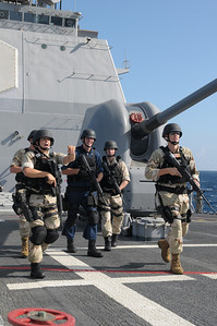 091211-N-0260R-006 - GULF OF ADEN (Dec. 11, 2009) - Members of the USS Chosin's (CG 65) Visit Board Search and Seizure (VBSS) team simulate approaching a suspect vessel during a training evolution.  Chosin is the flagship of Combined Joint Task Force 151, a multinational task force established to conduct counter-piracy operations under a mission-based mandate to actively deter, disrupt, and suppress piracy off the coast of Somalia. (U.S. Navy photo by Mass Communication Specialist 1st Class Brandon Raile/Released)