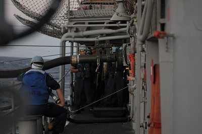 091212-N-0260R-083 - GULF OF ADEN (Dec. 12, 2009) - Sailors from the USS Chosin (CG 65) man a refueling station during an underway replenishment (UNREP) with USNS Kanawha. Chosin is the flagship of Combined Joint Task Force 151, a multinational task force established to conduct counter-piracy operations under a mission-based mandate to actively deter, disrupt, and suppress piracy off the coast of Somalia. (U.S. Navy photo by Mass Communication Specialist 1st Class Brandon Raile/Released)