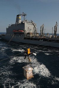 091125-N-0260R-037 - GULF OF ADEN (Nov. 25, 2009) - A pallet of stores is passed between the USNS John Lenthall and the USS Chosin (CG 65) during and underway replenishment  (UNREP). Chosin is the flagship of Combined Joint Task Force 151, a multinational task force established to conduct counter-piracy operations under a mission-based mandate to actively deter, disrupt, and suppress piracy off the coast of Somalia. (U.S. Navy photo by Mass Communication Specialist 1st Class Brandon Raile/Not Released)