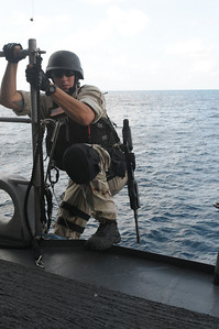 091124-N-0260R-031 - GULF OF ADEN (Nov. 24, 2009) - Members of the USS Chosin's (CG 65) Visit Board Search and Seizure (VBSS) team practice boarding techniques from one the ship's Rigid Hull Inflatable Boats (RHIB). Chosin is the flagship of Combined Joint Task Force 151, a multinational task force established to conduct counter-piracy operations under a mission-based mandate to actively deter, disrupt, and suppress piracy off the coast of Somalia. (U.S. Navy photo by Mass Communication Specialist 1st Class Brandon Raile/Released)