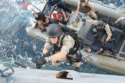 091124-N-0260R-035 - GULF OF ADEN (Nov. 24, 2009) - Members of the USS Chosin's (CG 65) Visit Board Search and Seizure (VBSS) team practice boarding techniques from one the ship's Rigid Hull Inflatable Boats (RHIB). Chosin is the flagship of Combined Joint Task Force 151, a multinational task force established to conduct counter-piracy operations under a mission-based mandate to actively deter, disrupt, and suppress piracy off the coast of Somalia. (U.S. Navy photo by Mass Communication Specialist 1st Class Brandon Raile/Released)