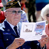 "Air Corps veteran, Rex Carnes, reads over the program during the Dedication of Service Flags at Roosevelt Park in Longmont on Saturday. <br /> For more photos and a video, go to  <a href=""http://www.timescall.com"">http://www.timescall.com</a> or   <a href=""http://www.dailycamera.com"">http://www.dailycamera.com</a>.<br /> Cliff Grassmick / June 9, 2012"