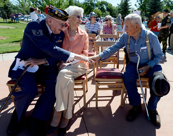 "Air Corps veteran, Rex Carnes, left, says hello to a fellow WWII vet, James Force, during the Dedication of Service Flags at Roosevelt Park in Longmont on Saturday. Carnes is joined by his wife, Wilma.<br /> For more photos and a video, go to  <a href=""http://www.timescall.com"">http://www.timescall.com</a> or   <a href=""http://www.dailycamera.com"">http://www.dailycamera.com</a>.<br /> Cliff Grassmick / June 9, 2012"