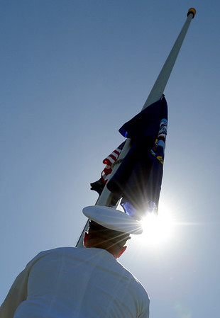 "Aaron Starks raises the Navy flag during the Dedication of Service Flags at Roosevelt Park in Longmont on Saturday.<br /> For more photos and a video, go to  <a href=""http://www.timescall.com"">http://www.timescall.com</a> or   <a href=""http://www.dailycamera.com"">http://www.dailycamera.com</a>.<br /> Cliff Grassmick / June 9, 2012"