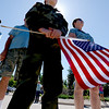 "Hayden McWhorter, 9, who has several war veterans in his family, listens to speakers  during the Dedication of Service Flags at Roosevelt Park in Longmont on Saturday. <br /> For more photos and a video, go to  <a href=""http://www.timescall.com"">http://www.timescall.com</a> or   <a href=""http://www.dailycamera.com"">http://www.dailycamera.com</a>.<br /> Cliff Grassmick / June 9, 2012"
