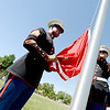 "Sgt. Ayinde Thomas, left, and Joshua Klohr, both of the Marine Corps, raise the flag of their military branch during the Dedication of Service Flags at Roosevelt Park in Longmont on Saturday.<br /> For more photos and a video, go to  <a href=""http://www.timescall.com"">http://www.timescall.com</a> or   <a href=""http://www.dailycamera.com"">http://www.dailycamera.com</a>.<br /> Cliff Grassmick / June 9, 2012"
