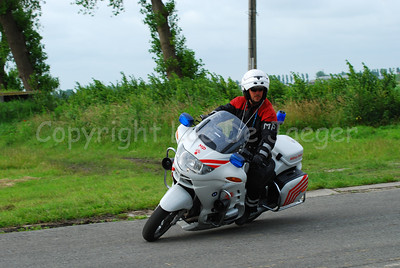 A member of the Military Police on a BMW R 1150 RT motorcycle. From July 2007 they will wear another unifom (with more reds in it an less black to be more visible from far away).