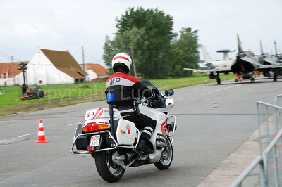 A member of the Military Police on a BMW R 1150 RT motorcycle. From July 2007 they will wear another unifom (with more reds in it and less black to be more visible).